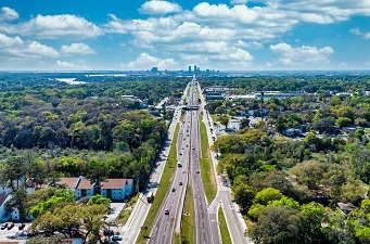 drone view of road beside RED BAY multifamily property